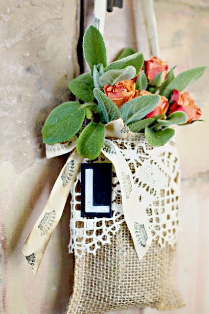 Burlap and Lace May Day Basket — this May Day pocket was made with burlap and vintage lace. The crafty ladies from Beehive Art Salon made sure the burlap pocket was big enough to accommodate a Mason jar. Who wouldn't love finding this on their doorknob? #diy #mayday #baskets