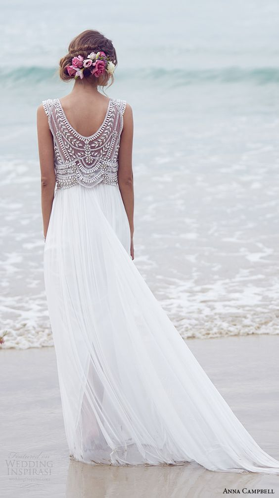 The detailing on the bodice of this gown is stunning, and look how gorgeous it and well-fitting it seems right on the beach.