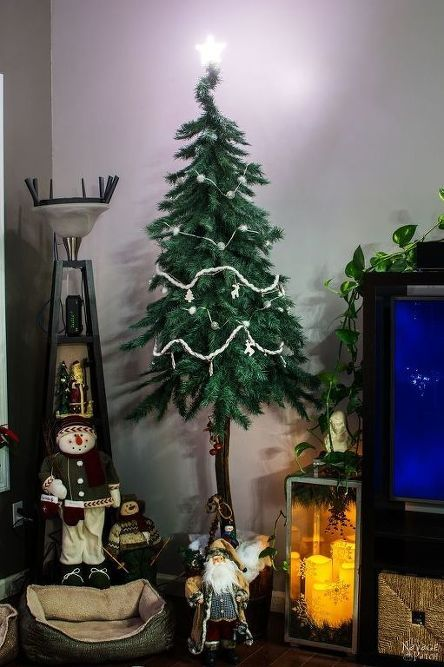 A husband and wife take apart a fake tree for this brilliant porch