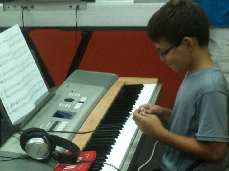 another student playing the piano.