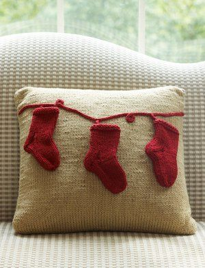 The Stockings in a Row Pillow is one of those timeless knit Christmas patterns that will bring a smile to your face as you take it down from the attic.