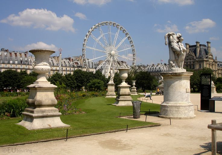Within the Tuileries you can find all kinds of statues, with this view leading to the travelling Ferris Wheel, which at the time was within the gardens.  You may be interested in more; www.eutouring.com/images_tuileries_garden.html