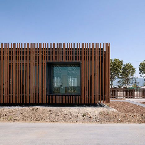 These photographs by Julien Lanoo show a French driving-test centre by Samuel Delmas Architectes, which is camouflaged to look like a fence. More »