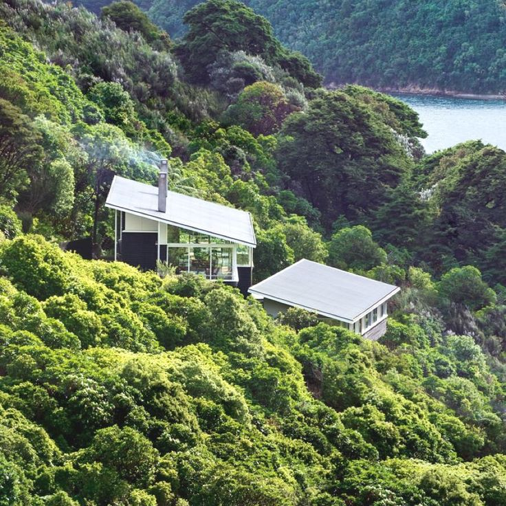 apple bay house has been designed by wellington-based designers parsonson architects. the contemporary property was finished in 2006 and is located in apple bay, marlborough sounds, new zealand.