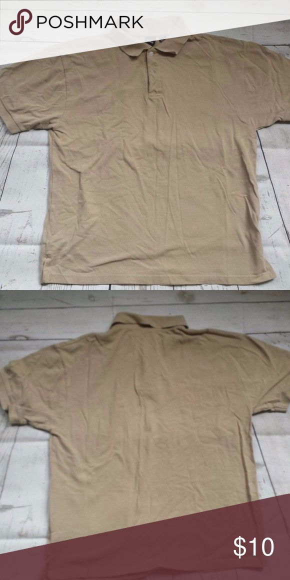 """Reebok Men's L short sleeve tan polo EUC Up for grabs is a gently used men's short sleeve polo shirt from REEBOK. Size L. 100% cotton. 2-button placket. Collar. Beige / Tan / Putty color. 22"""" wide. 27"""" long. Gently used with no signs of wear other than normal wash and use. Has gotten creased in storage but can be ironed. Smoke-free pet-free home. Check my other listings for more great stuff. I gladly combine shipping. Reebok Shirts Polos"""