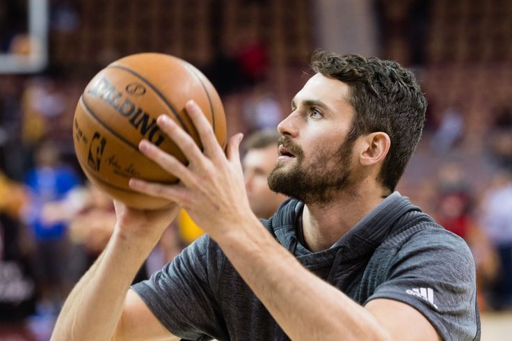UPDATED:  Cavs' Kevin Love (Back) Will Not Play Against Suns | Lower back soreness will keep Cavaliers forward Kevin Love out during Thursday's match-up against the Phoenix Suns, Cleveland head coach Tyronn Lue said during his pregame meeting with the media. | Kevin Love #0 of the Cleveland Cavaliers warms up prior to the game against the Golden State Warriors at Quicken Loans Arena on December 25, 2016 in Cleveland, Ohio. | 2017-01-19