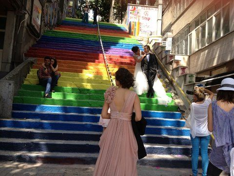 A public stairway in Istanbul's Beyoglu district, freshly painted in rainbow stripes, has become a popular photo backdrop.