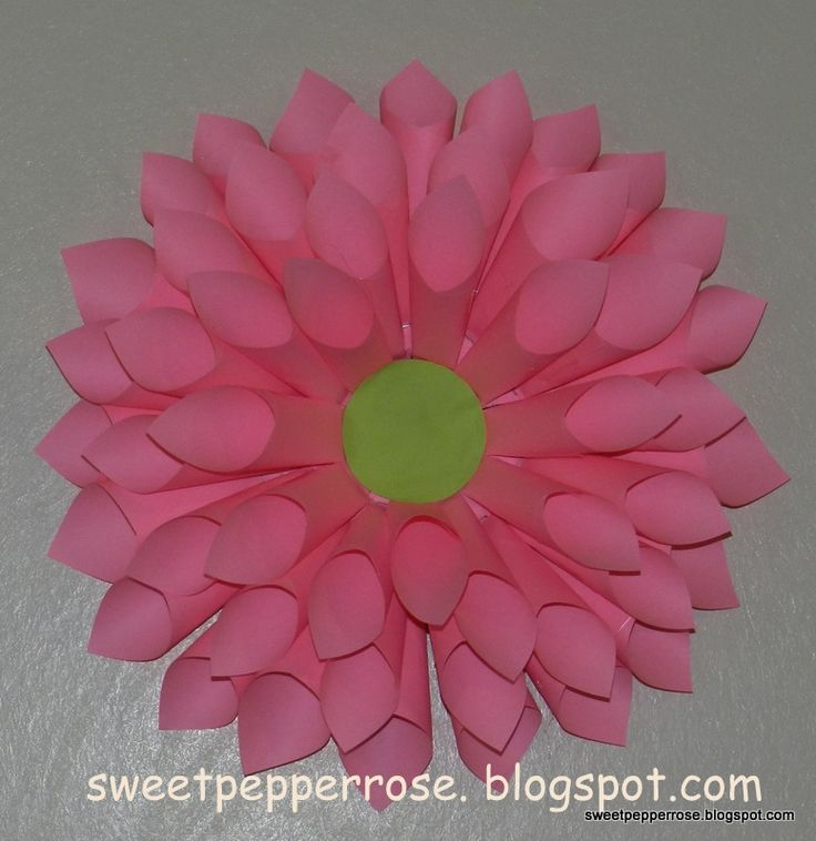 How to make a Big Pink Flower out of paper. I think a few of these would be really cute for a little girl's birthday party ;-)