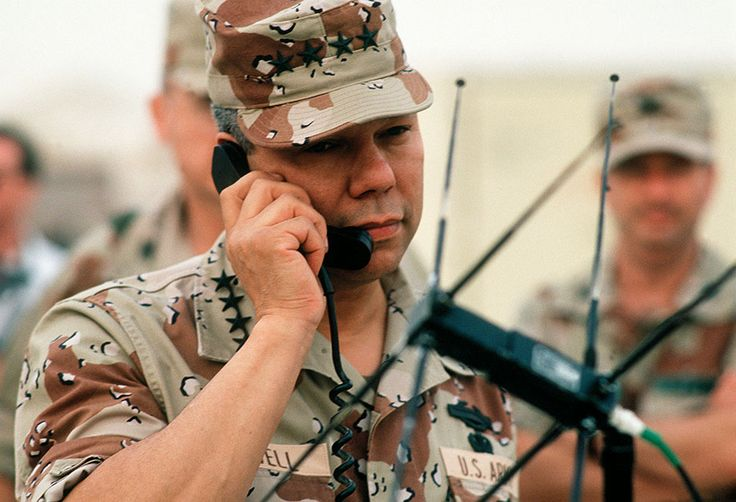 Chairman of the Joint Chiefs of Staff General Colin Powell speaks via satellite to Pentagon while visiting troops during Operation Desert Shield (DOD/Jeff Wright)