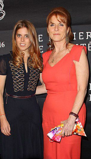 Sarah Ferguson recycles her favorite orange gown as she joins daughter Princess Beatrice at a star-studded charity ball in New York