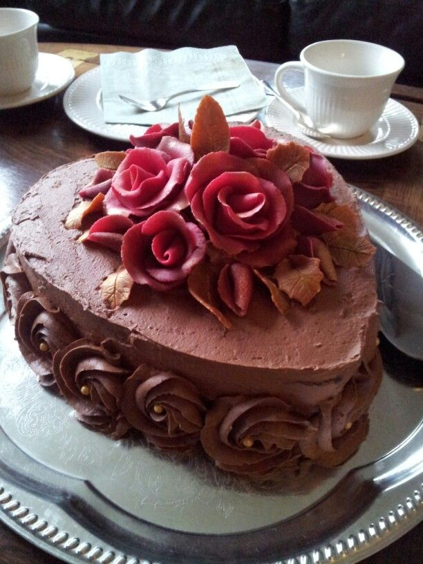 """Dad's birthday cake 2015: """"Nigella's"""" chocolate cake with an orange twist. Decorated with marcipan roses and buttercream rosettes."""