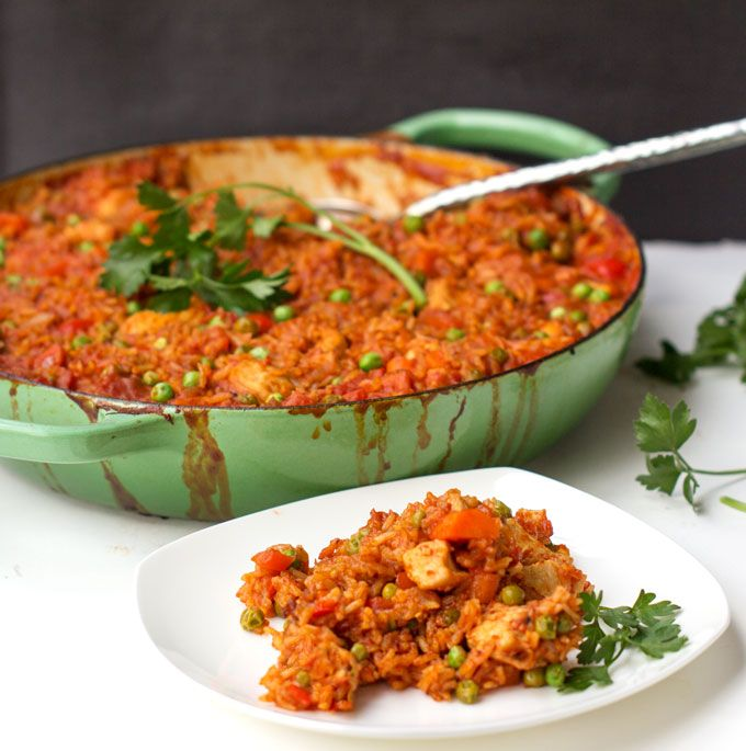 Jollof rice: a delicious, healthy dinner casserole from Ghana that the whole family will love - boneless chicken, rice, and vegetables in a delicious light tomato curry.