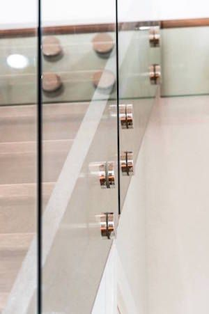 Stand-offs for glass balustrades and balconies