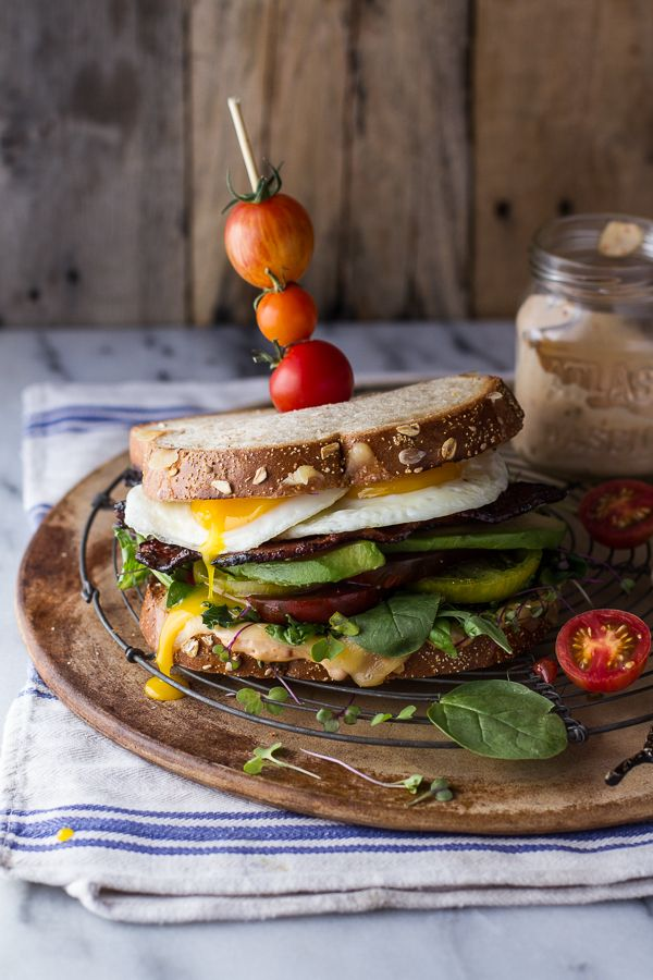 Flavorful Heirloom Tomato BLT w/Fried Eggs + Smoked Gouda, perfect for adding a little jazz to your Labor Day Weekend menu. Find it at halfbakedharvest.com