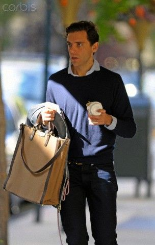 Michael Holbrook Penniman, Jr. aka Mika outside his hotel in New York City. Mika was holding coffee from Sant Ambroeus on one hand and his bag (with his initials M.H.P. embossed) while checking out of the Carlyle hotel on his way to the airport
