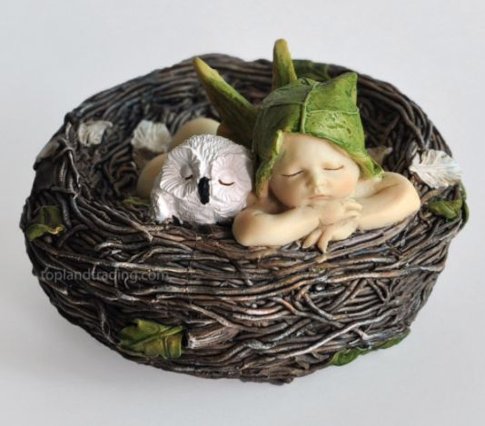 Sleeping baby fairy in a nest with an owl