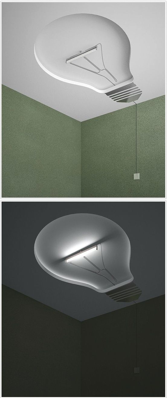 Ceiling light carved out of the ceiling in the shape of a light bulb! Brilliant idea...pun intended! LOL