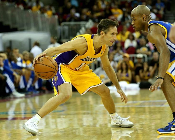 Steve Nash sizes up Jarrett Jack of the Golden State Warriors (Nash's 1st game as a LAL | October 7, 2012)