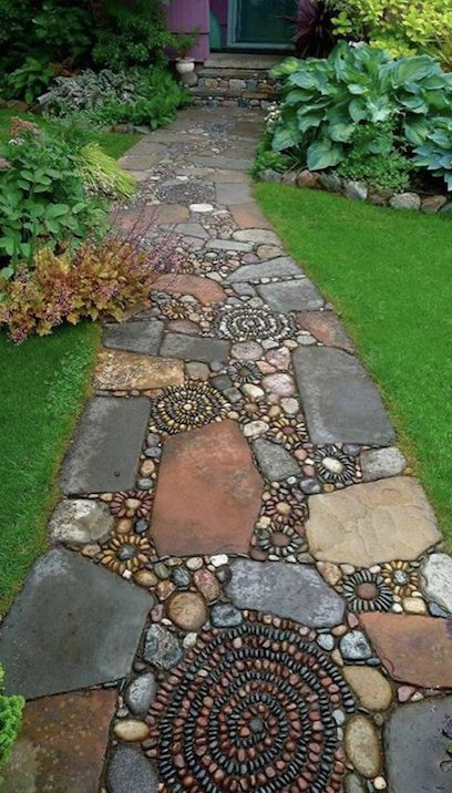 This mixed material mosaic walkway would look beautiful leading up to any home