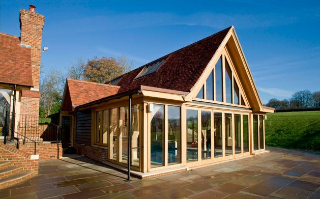 Indoor swimming pool building with green oak frame by Roderick James Architects