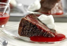 Triple Chocolate Pudding Cake with Raspberry Sauce - Can't believe this is made with cake mix and in your slow cooker! #recipe #cake