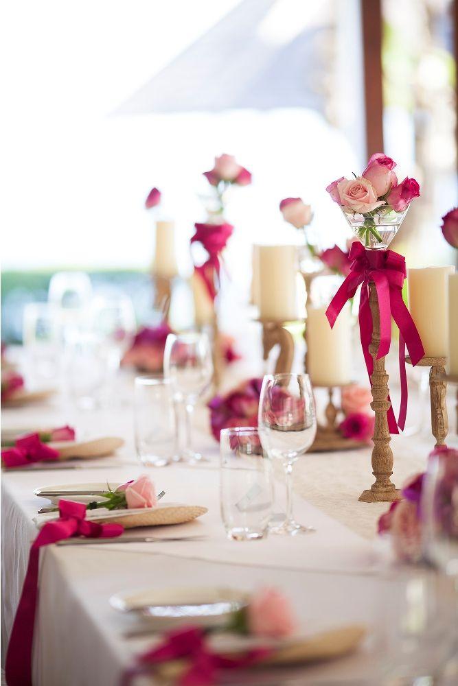 Hot pink bouquet adorning the Bridal Table 3 by Tirtha Bridal Uluwatu Bali