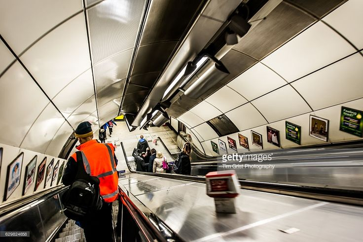 A view of commuters riding an escalator on the London Underground.