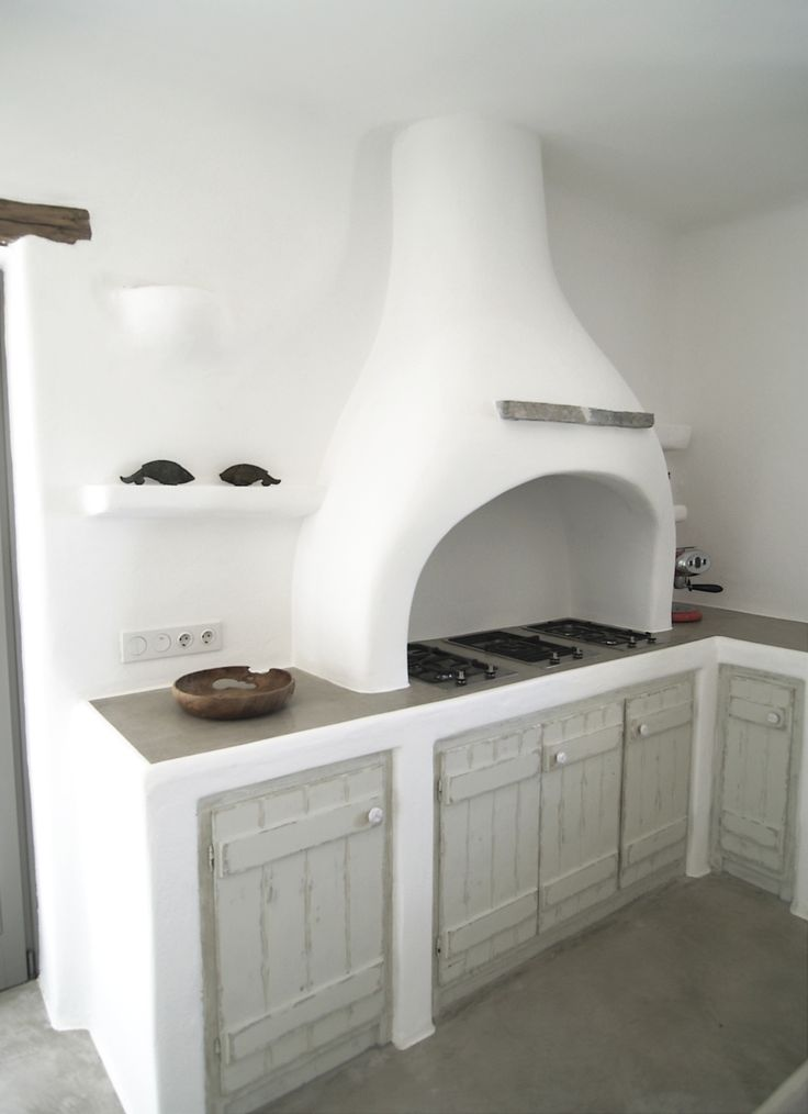 Paros, Greece. Traditional built kitchen counter and hood.
