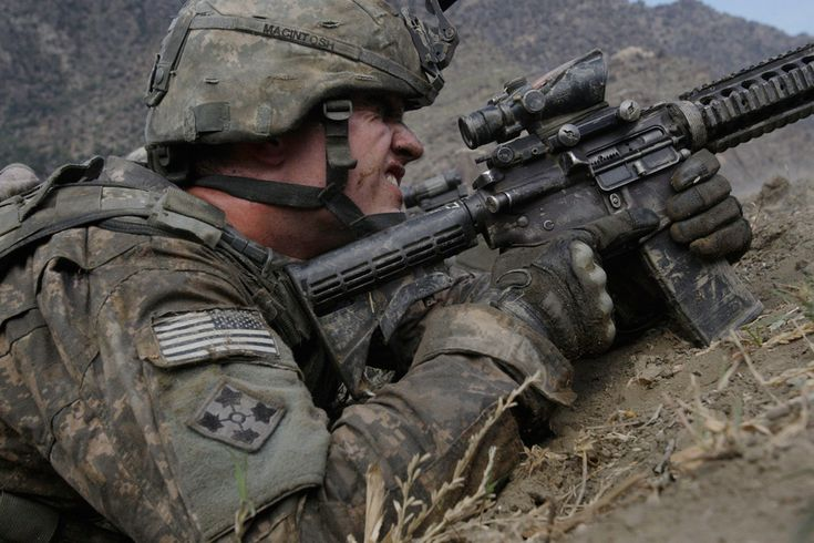 U.S. soldier PV2 John MacIntosh takes cover in farm field and scans the ridge line as Taliban fighters ambush U.S soldiers from the 2nd Battalion, 12th Infantry Regiment, 4th Brigade Combat Team, 4th Infantry Division during a patrol in the Pech Valley of Afghanistan's Kunar province on Tuesday, Nov. 3, 2009. (AP Photo/David Guttenfelder)  http://www.boston.com/bigpicture/2009/11/afghanistan_november_2009.html