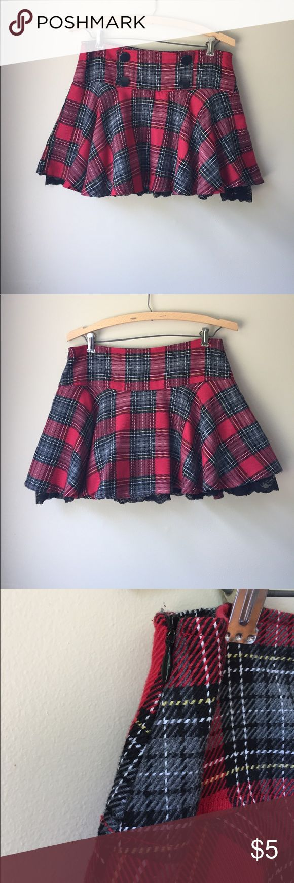 """Red Plaid Schoolgirl Lace Petticoat Mini Skirt This is a Plaid schoolgirl mini skirt with a side zip made by Forever 21 in a Size Medium. However, this brand runs small so that I why I have it listed as small. Waist: 15"""" & Length: approx 14"""". It has a black lace petticoat underneath. From a smoke and pet free home. Forever 21 Skirts Mini"""