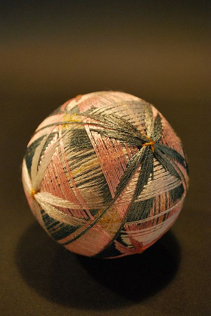 Temari balls are a form of folk art that originated in China and were introduced to Japan in the 7th century. The carefully hand-embroidered balls often made from the thread of old kimonos were created by parents or grandparents and given to children on New Year's day as special gift. by Nana Akua.