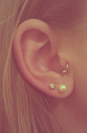 tragus piercing... I would love to get this one