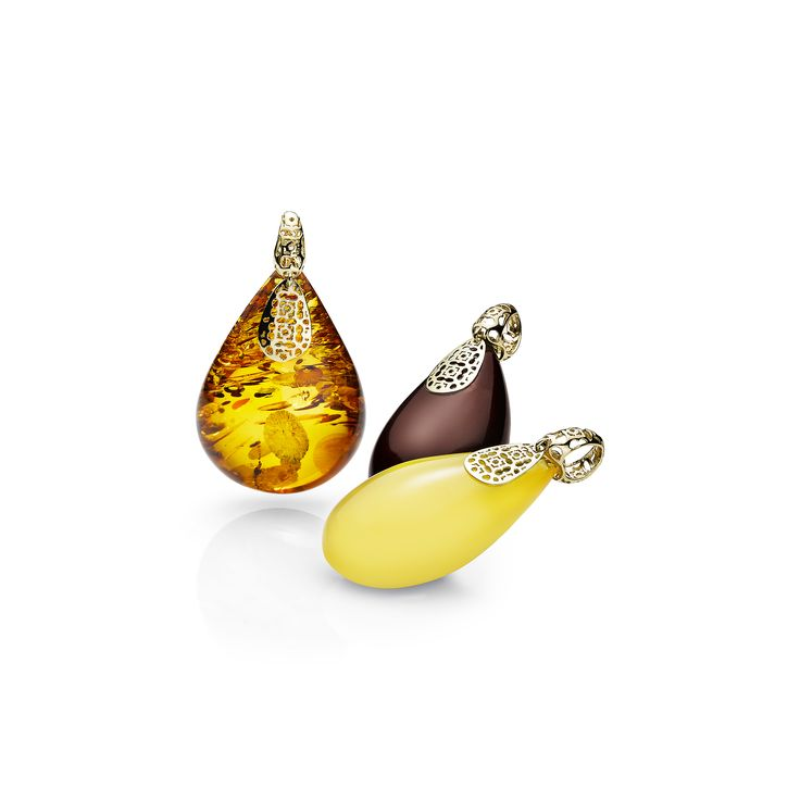 House of Amber - Stunning cognac, cherry and milky amber pendants designed by Zamir.