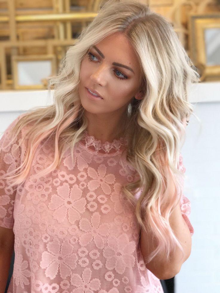 Blonde hair with peach peekaboos