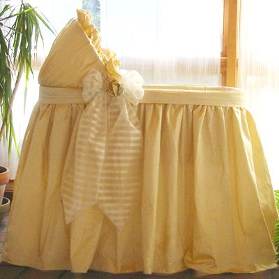 Baby bassinet in Yellow..love this idea for covering wicker bassinet