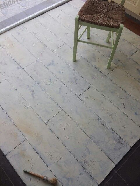 Floor painted patinated distressed.