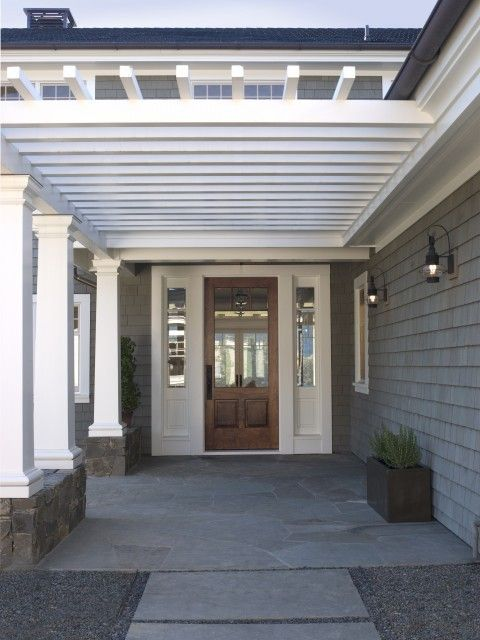 I love wood exterior doors.  Also love the colours of the house and walkway against the door and cream trim.
