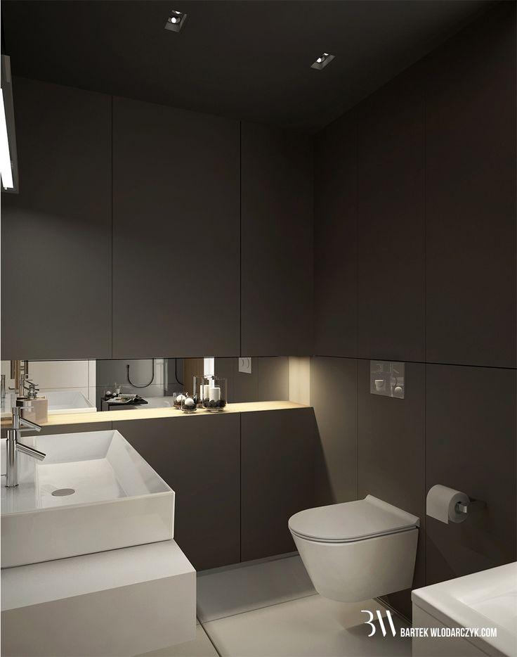 Minimalistyczna łazienka z podłogą Block White firmy Marazzi, ciemną zabudową ścienną, miską WC oraz umywalką firmy Catalano z baterią Steinberg