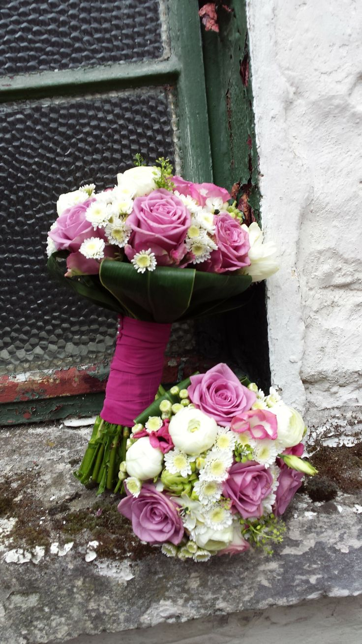 Coolwater rose, Ranuculus, lisianthus and ivory spray roses.