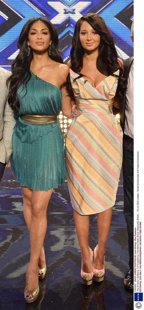 Nicole Scherzinger wears an emerald green Maria Lucia Hohan Tula dress while Tulisa wears a Vivienne Westwood frock.