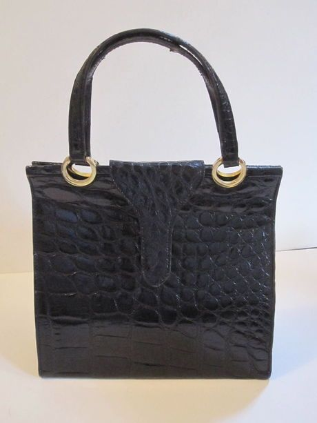 Shop my closet on @Jodie Guirey. I'm selling my Black Skin Vintage Handbag Bag. Only $99.00