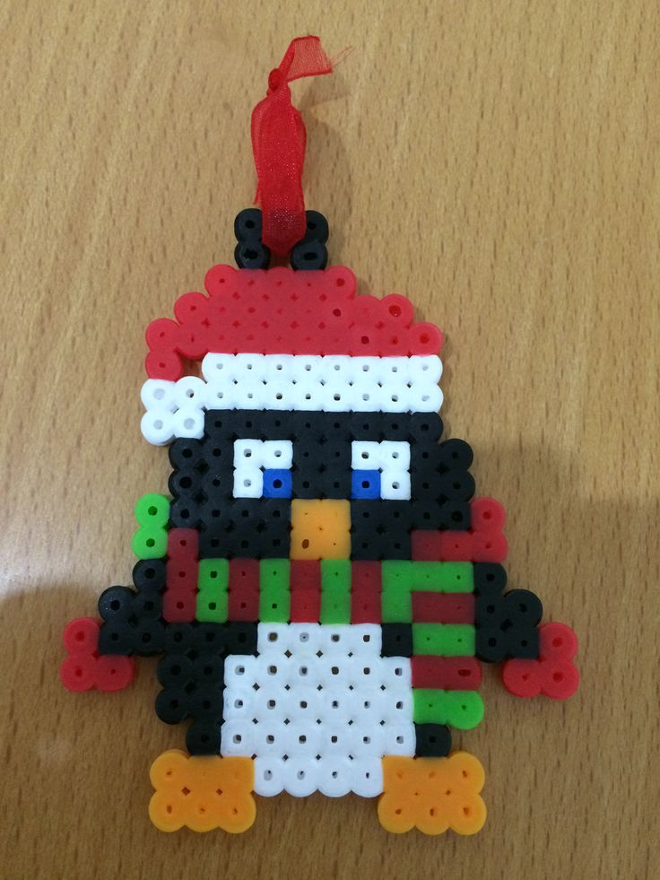 Penguin Ornament to your tree. It's for sale on Etsy: 5€.-