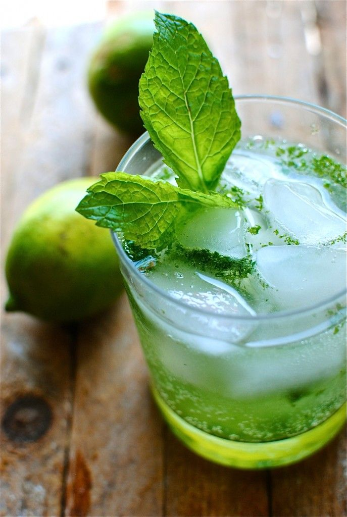 Mint Mojito  What it takes for 1 drink:  * 1 lime  * 10 mint leaves  * 1 Tbs. sugar  * 1.5 oz white rum  * splash of club soda  Using a mortar and pestle, grind 8 of the mint leaves with the sugar until it becomes a paste.  Spoon the paste into a glass. Drop a few ice cubes in the glass. Add the rum, club soda and a good squeeze of lime. Give a good stir, garnish with mint and sip, sip, sip!  Repeat as needed. And it will be needed.