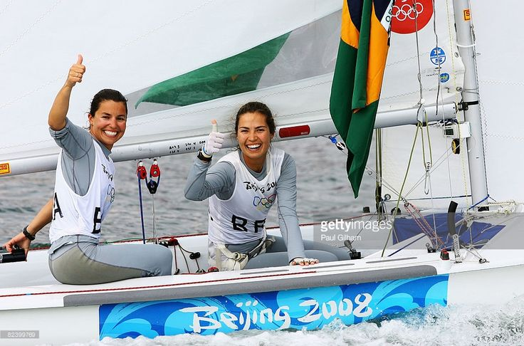 Isabel Swan and Fernanda Oliveira of Brazil celebrate after finishing third overall following the Women's 470 class medal race held at the Qingdao Olympic Sailing Center during day 10 of the Beijing 2008 Olympic Games on August 18, 2008 in Qingdao, China.