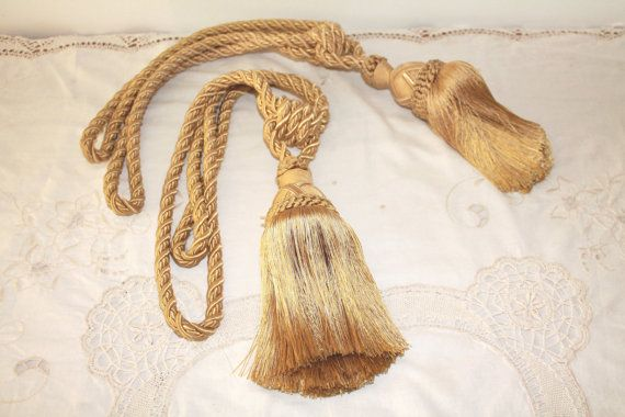 Pair of Curtain Tiebacks, Antique, French, Curtain Clip, Curtain holdback, Tiebacks, Tassels, Silk Cord, Rope Cord, French Decor   A pair of heavy quality handmade antique French curtain tiebacks dating from the early 1920s.  In antique tones of beige / golden colored threads.  These shabby style tiebacks will marry any style of interior adding a unique classic french finishing touch to your curtains. These antique French curtain tiebacks are luxurious and well made. The heavy doubled cord…