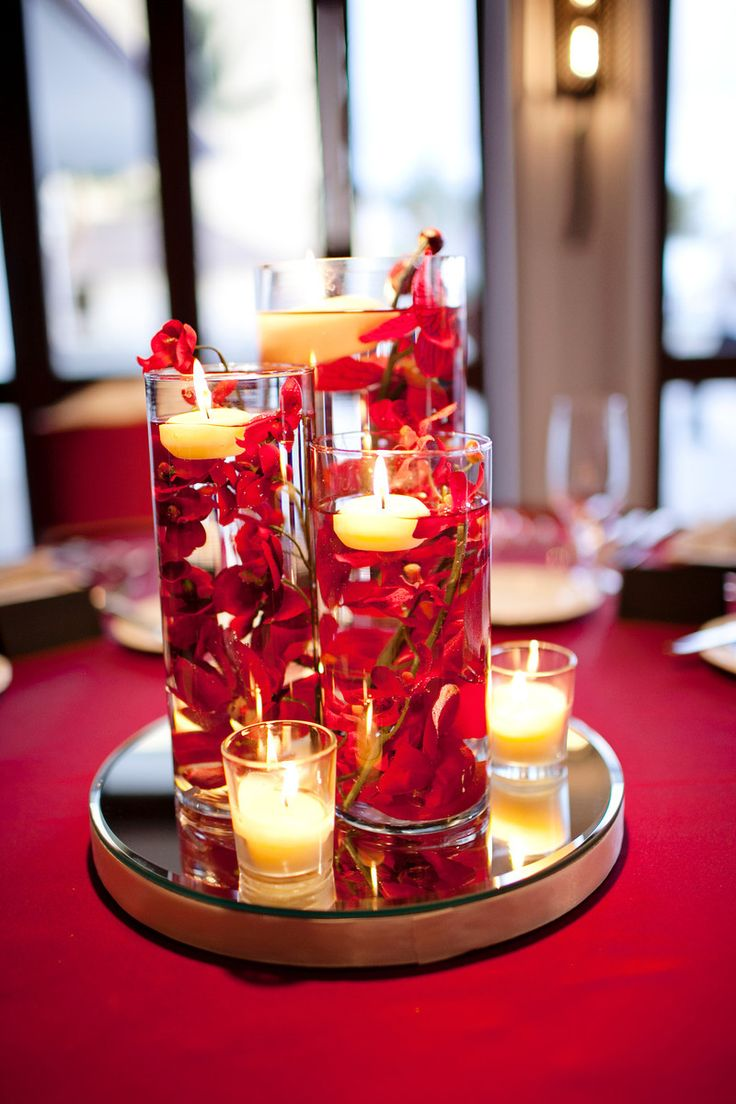 Our diy red wedding submerged floral centerpieces for Table arrangements