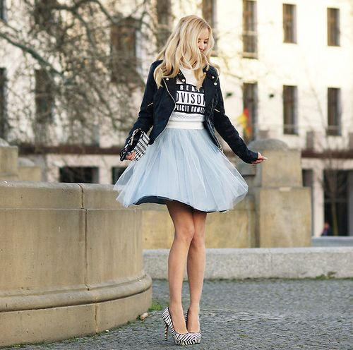 Shop this look for $311:  http://lookastic.com/women/looks/full-skirt-and-pumps-and-biker-jacket-and-cropped-sweater-and-clutch/2350  — Light Blue Tulle Full Skirt  — White and Black Vertical Striped Leather Pumps  — Black Suede Biker Jacket  — White and Black Print Cropped Sweater  — Black and White Geometric Leather Clutch