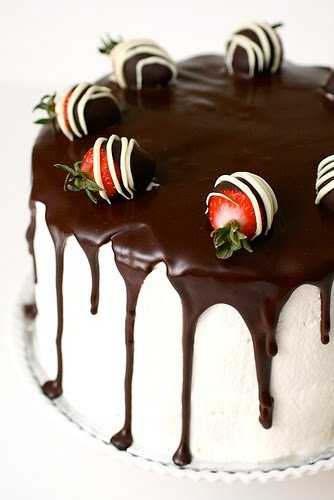 Chocolate cake with whipped cream frosting, chocolate ganache, and…