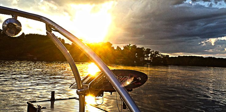 After a Lake Norman storm that almost filled my boat bilge, tore down trees, and flooded some roads, it offered this beautiful sunset while sitting on my boat.