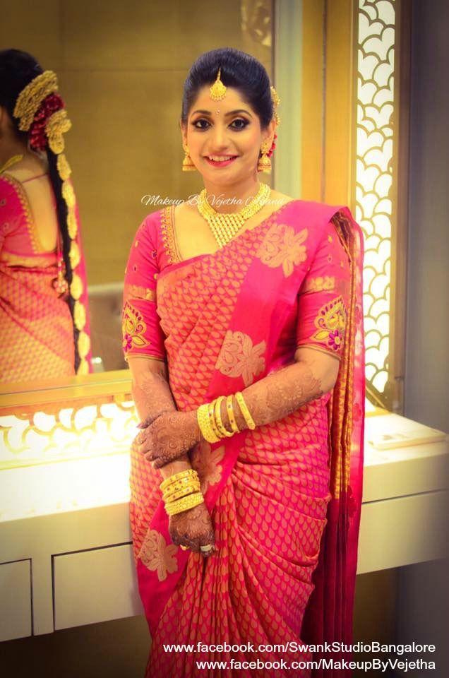 Our would-be bride Prakruta looks gorgeous for her engagement ceremony. Makeup and hairstyle by Vejetha for Swank Studio. Photo credit: Manish Ananda. Pink lips. Bridal jewelry. Bridal hair. Silk sari. Bridal Saree Blouse Design. Indian Bridal Makeup. Indian Bride. Gold Jewellery. Statement Blouse. Tamil bride. Telugu bride. Kannada bride. Hindu bride. Malayalee bride. Find us at https://www.facebook.com/SwankStudioBangalore